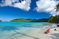 Red beach chairs <br /> Big Maho Bay beach<br /> Virgin Islands National Park<br /> St. John, U.S. Virgin Islands