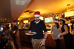 SWALEC staff volunteering to serve children from Craigiau School a Christmas lunch at the Claude Hotel in Cardiff..18.12.12.©Steve Pope