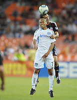 San Jose Earthquakes forward Geovanni (77) heads the ball while cover from behind by DC United defender Jed Zayner (12).  San Jose Earthquakes defeated DC United 2-0 at RFK Stadium, October 9, 2010.