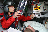 Doctor tends to patient in flight during a mission. Pictures of Norwegian Air Ambulance at work, operating out of Trondheim. The helicopter crew consist of a pilot, a crew member/rescue professional, and a physician.
