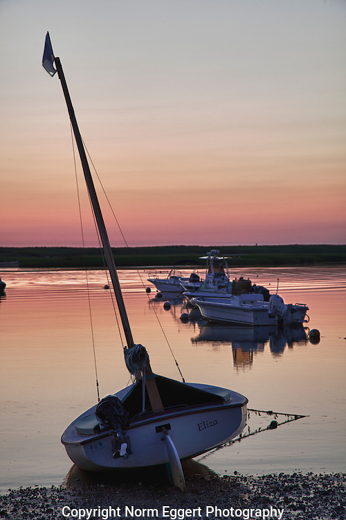 Sailboat is beached at low tide at Pamet Harbor in Truro, Massachusetts