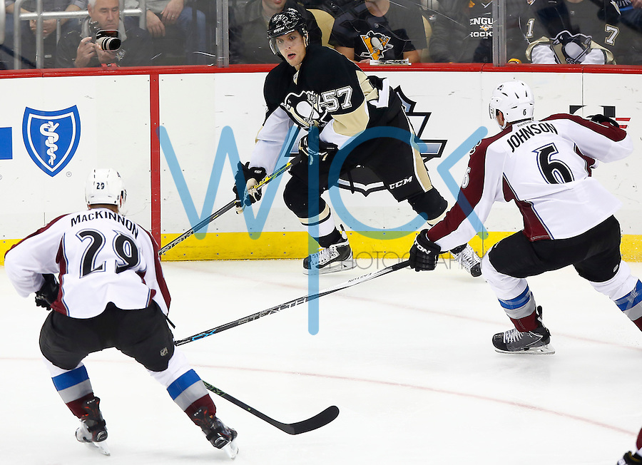 David Perron #57 of the Pittsburgh Penguins in action against the Colorado Avalanche at Consol Energy Center on November 19, 2015. (Photo by Jared Wickerham/DKPittsburghSports)