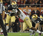 Florida State Seminoles linebacker Nigel Bradham (13) tackles running back Cierre Wood (20) in the third quarter.