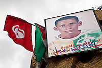Tunisia, Sidi Bouzid, il dopo rivoluzione. Ritratto di un martire della rivoluzione con accanto la bandiera della Tunisia.<br /> TUNISIA after spring revolution Sidi Bouzid<br /> image of a martyr
