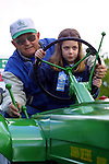 May 17, 2003 - (LtoR) Ellen Combs, 7, and grandfather Larry Brown slowly begin the parade route at the 68th Annual Linn County Lamb and Wool Fair. The Scio, Oregon, event features not only a themed parade but many lamb-related events and all join in to keep the tradition alive. They have the honor of pulling the float being ridden by Big Red the rooster and his owner Audie Heikkila.
