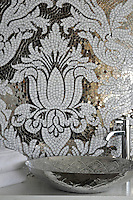 Kingston Lacy, a hand cut jewel glass mosaic shown in Absolute White and mirror, is seen here as a custom bathroom backsplash.<br />