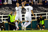 Cristiano Ronaldo of Real Madrid receives a high five from teammate Ezequiel Garay after a goal. Real Madrid beat the LA Galaxy 3-2 in an international friendly match at the Rose Bowl in Pasadena, California on Saturday evening August 7, 2010.