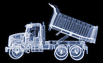 X-ray image of a dump truck (blue on black) by Jim Wehtje, specialist in x-ray art and design images.