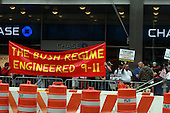 On the 10th anniversary of the September 11th attacks, on Broadway, several blocks from opening day of the September 11th Memorial at the World Trade Center site, in New York, New York on Sunday, September 11, 2011.  Members of the 9/11 Truth Movement protested, claiming the United States was behind the 9/11 attacks.Credit: Jefferson Siegel / Pool via CNP