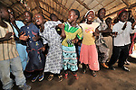 Children dance and sing with enthusiasm during Sunday morning worship at the United Methodist Church in Yei, a town in Central Equatoria State in Southern Sudan. NOTE: In July 2011, Southern Sudan became the independent country of South Sudan
