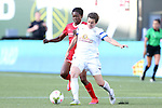 19 June 2015: Kansas City's Amy LePeilbet (17) clears the ball away from Portland's Genoveva Ayo Anonma (EQG) (behind). The Portland Thorns FC hosted FC Kansas City at Providence Park in Portland, Oregon in a National Women's Soccer League 2015 regular season match. The game ended in a 1-1 tie.