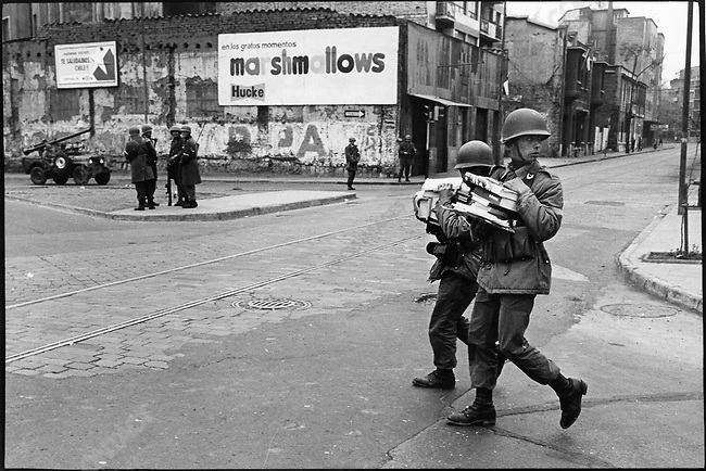In the aftermath of the coup, soldiers carry away allegedly subversive books, which will be burned. Santiago, Chile, September 1973