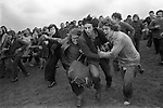 Bottle Kicking and Hare Pie Scrambling. Hallalton Leicestershire. England 1973. Easter Monday annually.<br />