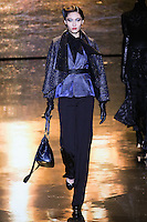Bonnie Chen walks runway in a midnight metallic tweed topper, indigo velvet denim vest, black chiffon blouse, and black stretch tuxedo twill pant, from the Badgley Mischka Fall 2011 fashion show, during Mercedes-Benz Fashion Week Fall 2011.