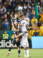 CARSON, CA – April 2, 2011: Philadelphia Union midfielder Stefani Miglioranzi (6) and LA Galaxy forward Miguel Lopez (25) rise above Philadelphia Union midfielder Kyle Nakazawa (13) and LA Galaxy midfielder Juninho (19) during the match between LA Galaxy and Philadelphia Union at the Home Depot Center, March 26, 2011 in Carson, California. Final score LA Galaxy 1, Philadelphia Union 0.