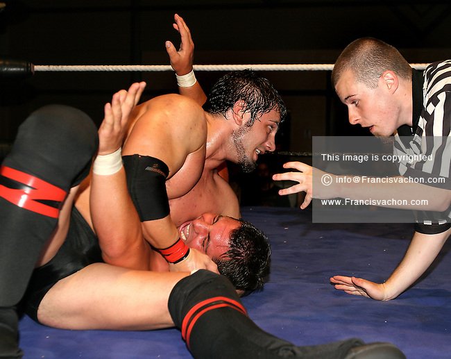 Pro Wrestler Austin Aries applies a hold on Excess during a professional wrestling match of the Elite Wrestling Revolution federation event held at Le Centre Horizon in Quebec City July 22, 2004<br />