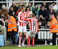 Peter Crouch of Stoke City celebrates scoring their first goal with Phillip Bardsley of Stoke City