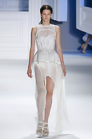 Katlin Aas walks runway in a White striped silk-linen carved hem gown, and White mackintosh cotton eyelet corset and peplum belt, by Vera Wang, for the Vera Wang Spring 2012 collection, during Mercedes-Benz Fashion Week Spring 2012.
