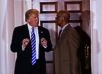 United States President-elect Donald Trump (L) shakes hands with Bob Woodson (R) at the clubhouse of Trump International Golf Club, November 19, 2016 in Bedminster Township, New Jersey. <br /> Credit: Aude Guerrucci / Pool via CNP /MediaPunch
