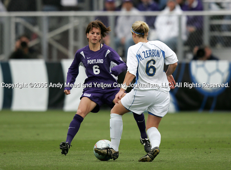Portland's Angie Woznuk (l) defends against UCLA's McCall Zerboni (r). The University of Portland Pilots defeated the UCLA Bruins 4-0 to win the NCAA Division I Women's Soccer Championship game at Aggie Soccer Stadium in College Station, TX, Sunday, December 4, 2005.