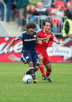 22 May 2010: New England Revolution defender Kevin Alston #30 and Toronto FC midfielder Nick LaBrocca #21in action during a game between the New England Revolution and Toronto FC at BMO Field in Toronto..Toronto FC won 1-0.....