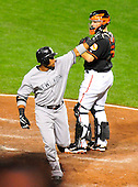 New York Yankees second baseman Robinson Cano (24) waves to his fans after he homered in the sixth inning against the Baltimore Orioles at Oriole Park at Camden Yards in Baltimore, Maryland in the second game of a doubleheader on Sunday, August 28, 2011.  The Yankees won the game 8 - 3, earning a split in the two games..Credit: Ron Sachs / CNP.(RESTRICTION: NO New York or New Jersey Newspapers or newspapers within a 75 mile radius of New York City)
