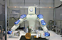 Okonomiyaki Robot during a demonstration at the International Robot Exhibition in Tokyo on November 27, 2009. 200 robot companies and institutes exhibit their latest robot technologies during a four-day exhibition (photo Laurent Benchana/Nippon News).