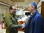 Iraq's Deputy Interior Minister Aqeel al-Khazali (left) greets Father Michel Jalakh, general secretary of the Middle East Council of Churches, during the visit of an ecumenical delegation to al-Khazali's office in Baghdad on January 21, 2017.