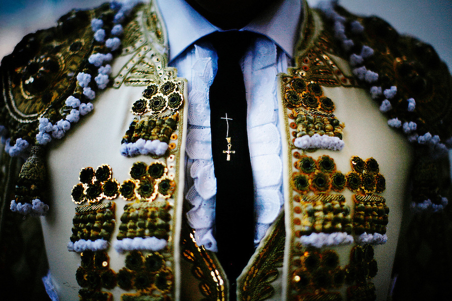 Tijuana, Baja de California, MX, July 1, 2007 - Matador, Omar Villasenor, shows a cross he sewed onto  his tieMatador Omar Villaseñor shows a cross he sewed onto his tie for good luck before a fight at Plaza Monumental, Tijuana, Baja de California, Mexico, July 1, 2007. A bullfighter for six years, he has earned a fearless reputation which makes him a favorite to the crowd. His approach has also cost him many injuries.. for good luck before a fight at Plaza Monumental.