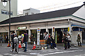 March 11, 2011, Tokyo, Japan - Roads flooded and workers evacuate buildings in the Greater Tokyo area as a series of earthquakes struck JapanÅfs northeastern prefectures. Hundreds of people are feared dead after the countryÅfs biggest earthquake with a magnitude of 8.9 since records began struck the northeastern coasts, unleashing a 10-metre tsunami that swept away buildings, ships and vehicles. (Photo by AFLO) [3609] -mis-