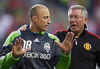 Seattle Sounders FC goalkeeper Kasey Keller talks with Manchester United Manager Sir Alex Ferguson after play at CenturyLink Field in Seattle Wednesday July 20, 2011. Manchester United won the match 7-0.
