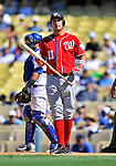 24 July 2011: Washington Nationals third baseman Ryan Zimmerman looks to third base coach Bo Porter for a sign during game action against the Los Angeles Dodgers at Dodger Stadium in Los Angeles, California. The Dodgers defeated the Nationals 3-1 to take the rubber match of their three game series. Mandatory Credit: Ed Wolfstein Photo