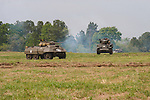 """Reenactors showcase World War II tanks, half-tracks and support vehicles during the Museum of the America G.I.'s annual Open House on March 29, 2008 in College Station, Texas.   At left is a  M8 """"Greyhound""""  armored car and a M5 Stuart is at right."""