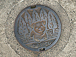 Photo shows one of the manhole covers decorated with an image of an Akita Inu in Odate City, Akita Prefecture Japan. The dog was formerly known as the Odate Inu. Photographer: Rob Gilhooly