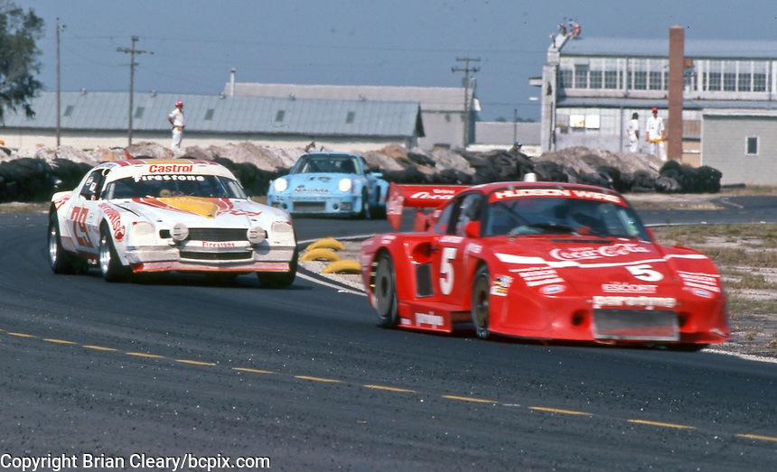 The #5 Bob Akin Motor Racinf Porsche 935K3 of Bob Akin, Dale Whittington and John O'Steen leads the #29 Chevrolet Camaro of Robert Overby, Don Bell and Chris Doyle and another car at  the 12 Hours of Sebring endurance sports car race, March 19, 1983.  (Photo by Brian Cleary/www.bcpix.com)