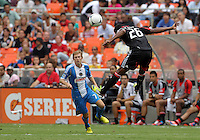 WASHINGTON, D.C. - AUGUST 19, 2012:  Newly aquired Lionard Pajoy (26) of DC United heads the ball away from former teammate Brian Carroll (7) of the Philadelphia Union during an MLS match at RFK Stadium, in Washington DC, on August 19. The game ended in a 1-1 tie.