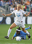 1 December 2006: North Carolina's Kristi Eveland (32) gets between the ball and UCLA's Danesha Adams (behind). The University of North Carolina Tarheels defeated the University of California Los Angeles Bruins 2-0 at SAS Stadium in Cary, North Carolina in an NCAA Division I Women's College Cup semifinal game.