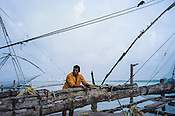Local fisherman gather to fish on the banks of the backwaters in Fort Kochi, Kerala, India.