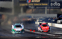 Feb. 21, 2010; Chandler, AZ, USA; NHRA funny car driver Ashley Force Hood (left) defeats Melanie Troxel in the first round of eliminations during the Arizona Nationals at Firebird International Raceway. Mandatory Credit: Mark J. Rebilas-