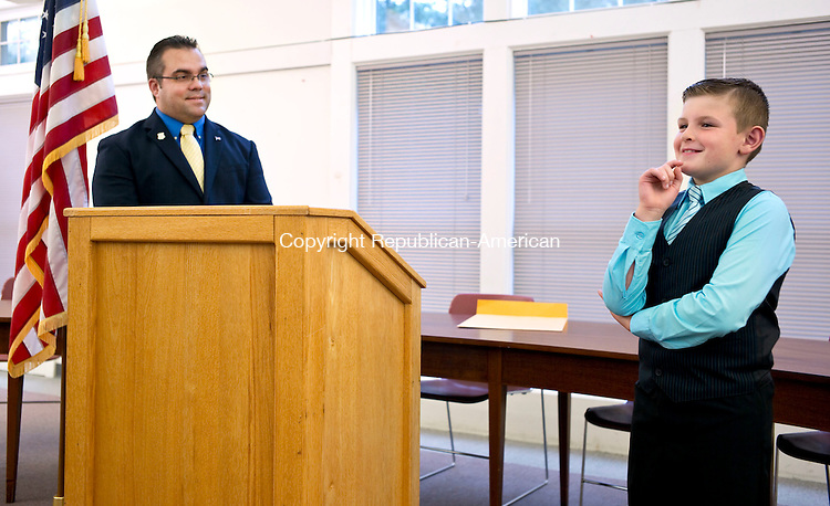 """Harwinton, CT- 30 September 2015-093015CM14- Chad Edmond, 8, of Harwinton, answers a question at the Harwinton Town Hall on Wednesday.  Looking on is Harwinton First Selectman, Michael Criss.  Edmond was named """"Selectman of the Day"""" after participating in the summer program, """"Readers are Leaders"""".     Christopher Massa Republican-American"""