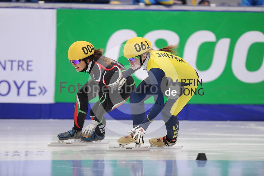"""SHORT TRACK: MOSCOW: Speed Skating Centre """"Krylatskoe"""", 14-03-2015, ISU World Short Track Speed Skating Championships 2015, Ranking Races, Raya ZAHARIEVA (#004   BUL), Safiya VLASOVA (#061   UKR), ©photo Martin de Jong"""