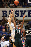 24 February 2012: Duke's Haley Peters (33) shoots over Miami's Sylvia Bullock (34). The Duke University Blue Devils defeated the University of Miami Hurricanes 74-64 at Cameron Indoor Stadium in Durham, North Carolina in an NCAA Division I Women's basketball game.