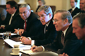 United States President George W. Bush starts a meeting with his Cabinet in the Cabinet Room of the White House in Washington, D.C. on Thursday, October 11, 2001.  From left to right: U.S. Department of Health and Human Services (HHS) Secretary Tommy Thompson; U.S. Secretary of State Colin Powell; the President; U.S. Secretary of Defense Donald Rumsfeld; and U.S. Secretary of Commerce Donald Evans..Mandatory Credit: Eric Draper - White House via CNP.