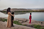 17/04/15. Goktapa, Iraq. Rahima, Ali and Dhuha by the river.