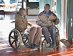 Forai Tapambwa (left) and Dominik Tengani talk outside the Harare offices of the Spinal Injuries Association of Zimbabwe, which supports and advocates for the rights of people living with spinal injuries. They both use appropriately-designed and fitted wheelchairs provided by the Jairos Jiri Association with support from CBM-US.