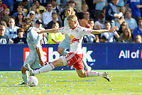 Red Bulls defender Tim Ream (5) stretches out to stop Sporting KC midfielder Graham Zusi from making a cross... Sporting Kansas City defeated New York Red Bulls 2-1 at LIVESTRONG Sporting Park, Kansas City, Kansas.