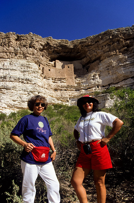 Two female tourists below Montezumas Castle in Arizone, USA