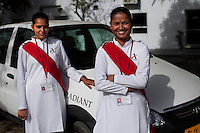 Ekta Yadav aged 28 (right) and Mamta aged 26 (left) pose for a photo on 30th March 2010 in Radiant Limousine compounds.<br /> These female drivers were part of a program by Azad Foundation.<br /> Currently training their 4th batch of students, Azad Foundation was set up by Meenu Vadera (Executive Director) in New Delhi, India, to train Indian women in driving services. Upon completion, these women work as personal drivers for a period of time before they upgrade their driving licences to commercial licences, allowing them to drive taxis. With this program, Azad aims to empower Indian women including those previously abused or trafficked, while making Delhi a safer place for women travelling in public transport. Photo by Suzanne Lee for Panos London