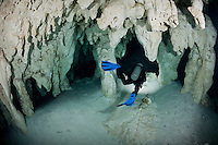 RX0106-D. scuba diver (model released) follows a line marking the route through caverns and tunnels accessed from the surface via a cenote in the jungle. This underground river system spiders across the Yucatan Peninsula, an eerie realm known by the local Maya people as Xilbalba which translates into Place of Fear. Riviera Maya, Yucatan Peninsula, Mexico.<br /> Photo Copyright &copy; Brandon Cole. All rights reserved worldwide.  www.brandoncole.com