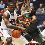 "Mississippi's Murphy Holloway (31) has the ball knocked away by Miami's Malcolm Grant (3) at the C.M. ""Tad"" Smith Coliseum in Oxford, Miss. on Friday, November 25, 2011. (AP Photo/Oxford Eagle, Bruce Newman)."